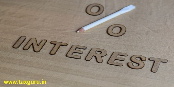 INTEREST written in 3d wooden alphabet letters with a percentage sign