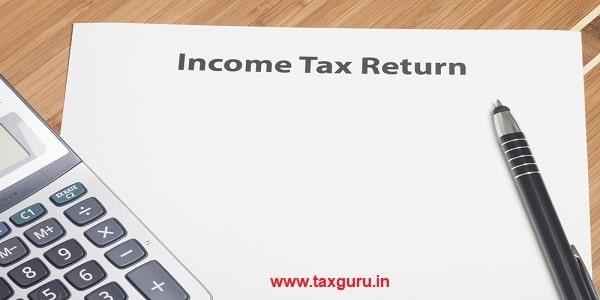 Income Tax Returns write in white paper