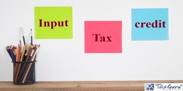 Input Tax Credit - Crayons and paper note on wall background