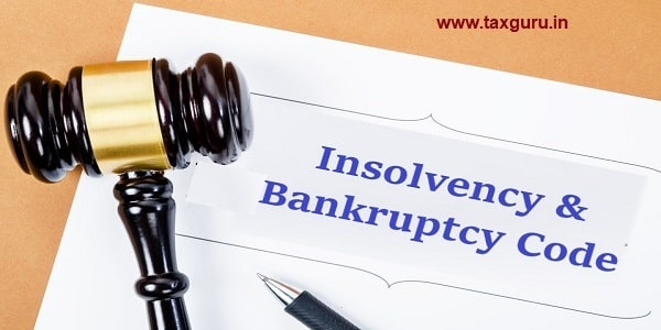 Insolvency & Bankruptcy Code document with wooden gavel, Buseniss concept.