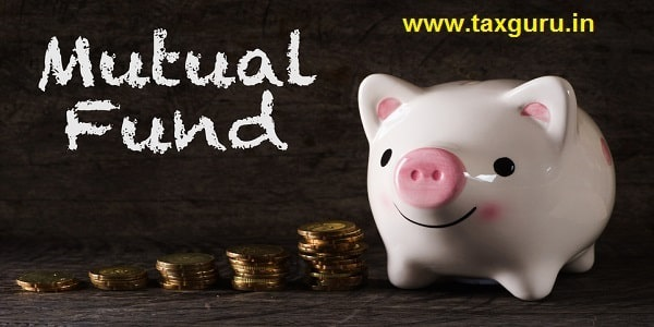 """""""Mutual fund"""" words with Piggy bank and stack of golden money increased with wooden background"""
