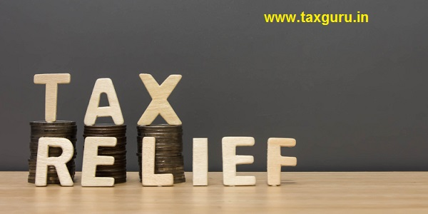 Wood tax relief word and money coin stack on wooden table background