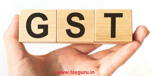 Wooden small cubes with GST letters isolated on white background