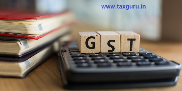 Word of GST spelled with colorful wooden alphabet blocks