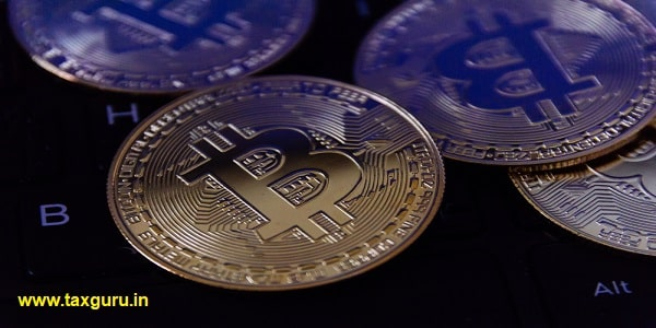 bitcoin is place on the keyboard of the laptop, cryptocurrency trading technology concept