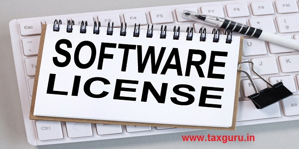 software license, text on white paper on white keyboard on gray background
