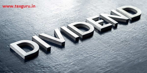 word dividend laid by volumetric silver metal letters on gloss painted board