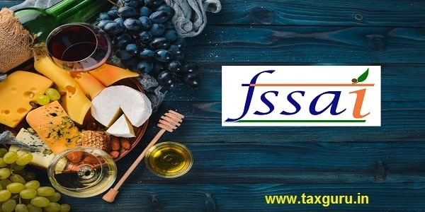 A large assortment of cheeses, wine, honey, nuts and spices, on a blue wooden table with fssai icon