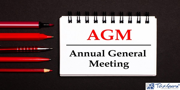 A white notepad with the text AGM Annual General Meeting