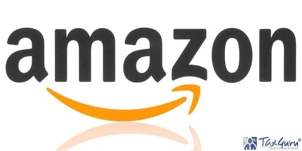 Amazon logotype printed on paper. Amazon is an American electronic commerce company