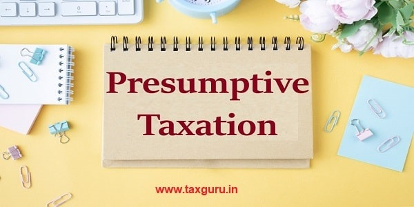 Businessman holding a card with text Presumptive Taxation
