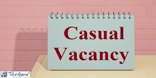 Casual Vacancy write on Blue calendar mock-up on yellow wooden table