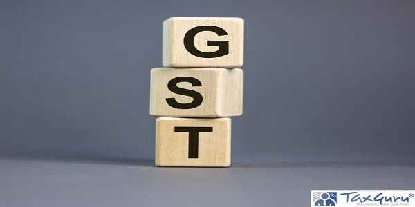 Concept words 'GST, goods and services tax' on cubes on a beautiful grey background