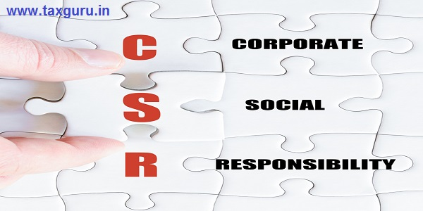Corporate Social Responsibility - Hand of a business man completing the puzzle with the last missing piece