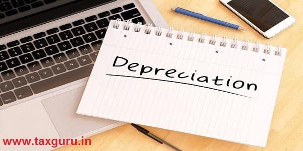 Depreciation - handwritten text in a notebook on a desk