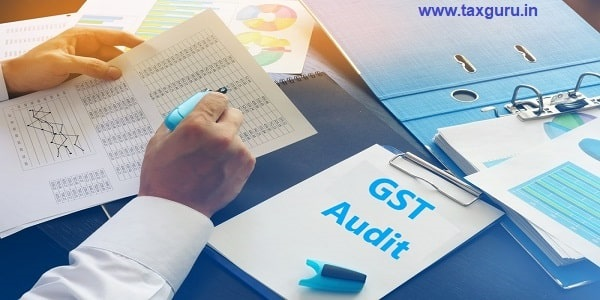 Document with title GST Audit on an office table