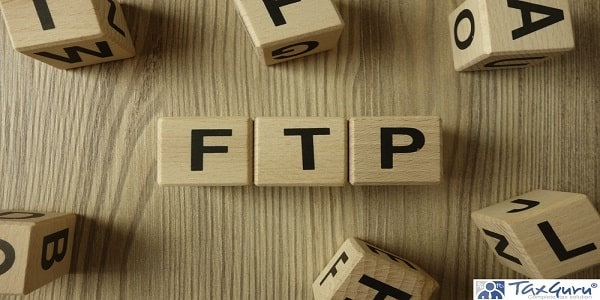 Foreign Trade Policy (FTP) word from wooden blocks on desk