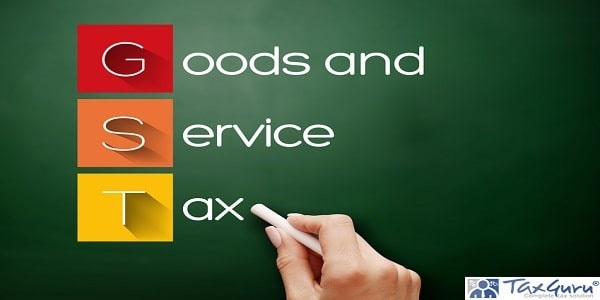 GST - Goods and Service Tax acronym, business concept background on blackboard
