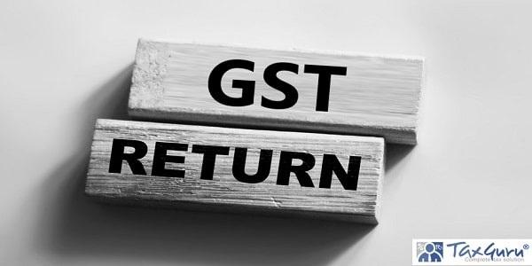 GST return text on wooden blocks on grey background