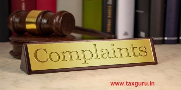 Golden sign with gavel and complaints