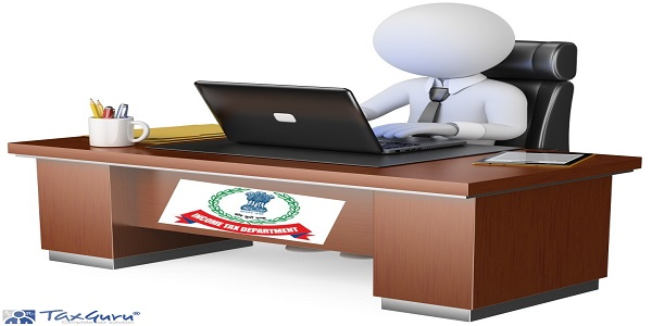 Income Tax Department - Businessman working at office with his computer