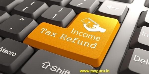 Income Tax Refund - Orange Button on Computer Keyboard