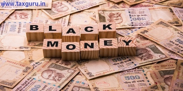 Indian currency 500 rupee notes lying on ground with Black Money written using wooden blocks