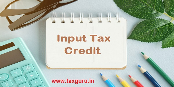 Input Tax Credit text concept write on notebook with office tools on blue background