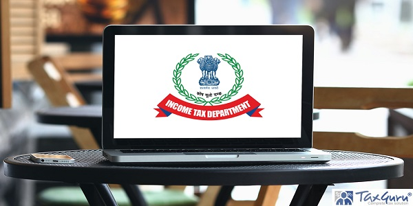 Laptop with Income Tax Department screen on table
