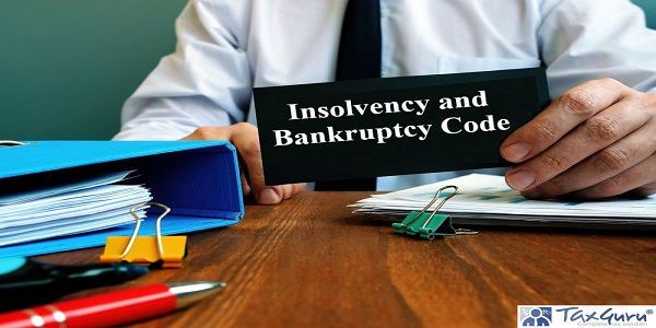Man holds note Insolvency and Bankruptcy Code