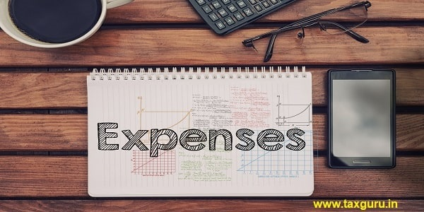 Notebook with text inside Expenses on table with coffee