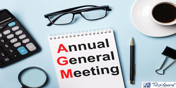 On a blue background, glasses, calculator, coffee, magnifier, pen and notebook with the text Annual General Meeting