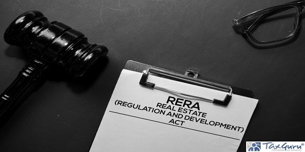 Real Estate Regulation and Development Act (RERA) text on Document and gavel isolated on office desk