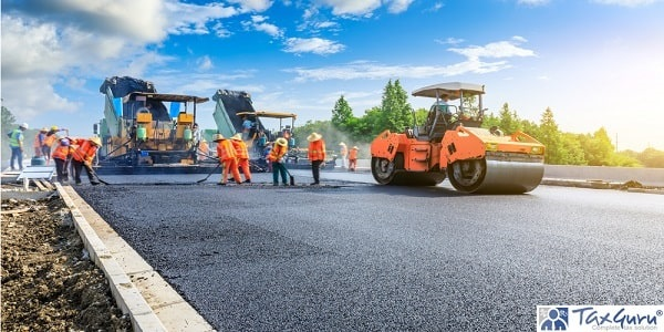 Road construction workers and road construction machinery scene