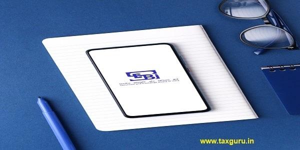 SEBI logo on phone screen stock image