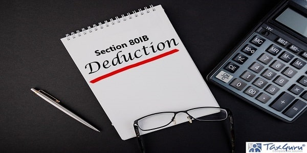 Section 80IB deductions notepad writing concept on dark background with pen and calculator