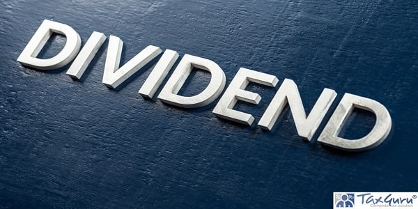 The word dividend laid by volumetric silver metal letters