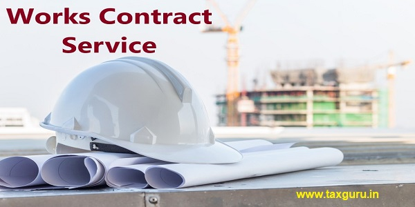 Works Contract Service - The white safety helmet and the blueprint at construction site