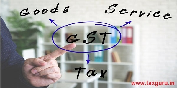 Young bussines man in a GST writing on an background