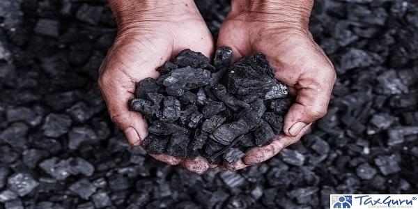 coal miner in the man hands of coal background