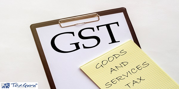 white and yellow paper with text GST GOODS AND SERVICES TAX on a white background with stationery