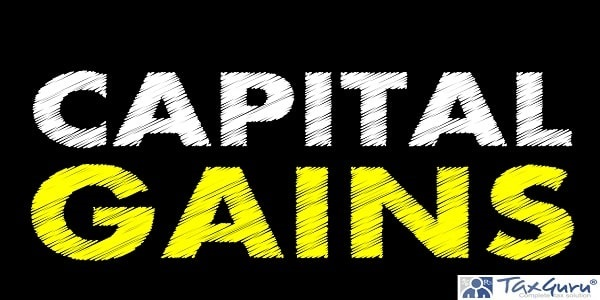 Capital gains writing text on black chalkboard