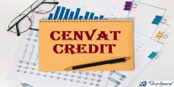 Cenvat Credit is written on a notepad on an office desk with office accessories
