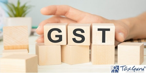 GST (Goods and service Tax) text on wooden table for your design