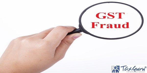 Hand showing GST fraud word through magnifying glass
