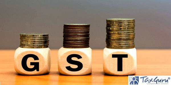 Wood cube block letters GST and money coin stack on table wooden gray background