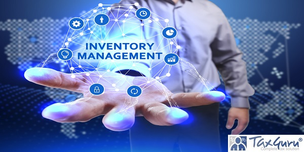 Young businessman shows the word on the virtual display of the future - Inventory management