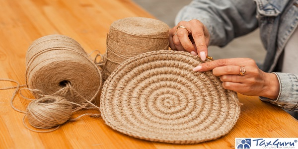 hands craftswoman knitting product from jute